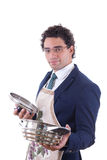 Man with an apron holding a cooking pot Stock Photos
