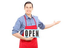 Man with apron holding an open sign Stock Photography