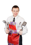 Man in the apron holds kitchen accessories Stock Photography
