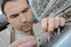 Man in apron making duplicates keys Royalty Free Stock Photo