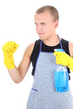Man in apron posing with cleaning supplies Royalty Free Stock Photography