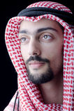 Man in arab clothing. On the black Royalty Free Stock Photo