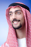 Man in arab clothing. On blue Stock Image