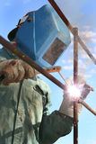 Man Arc welder. Man arc welding pipe outside stock images