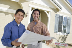 Man With Architect Discussing House Plans Stock Image