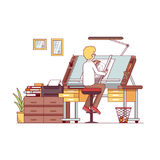Man architect drawing project at designer studio. Man architect drawing or making project at designer studio with adjustable desk, chair, drawers. Workshop or Royalty Free Stock Images