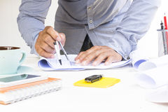 Man architect using circus for project plan with equipment on white table.Zoom in. Stock Image