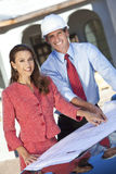 Man Architect & Woman on Construction Site Stock Photos