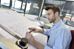 Man architect working on a project Stock Photos