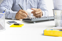 Man architect writing notebook on white table and equipment for work.Zoom in. 1 Royalty Free Stock Photos