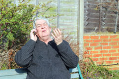 Man arguing on a mobile phone. Royalty Free Stock Photography