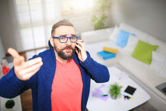 Man arguing on the phone Stock Image
