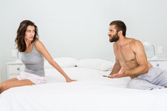 Man arguing with woman on bed Royalty Free Stock Images
