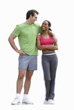 Man with arm around woman, sports clothing, smiling, cut out Royalty Free Stock Photography