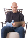 Man with arm cast using an accessible tablet Stock Image