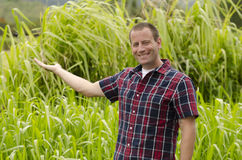 Man with arm extended and empty hand. Man with arm extended and empty hand with tropical foliage in the background Stock Photography