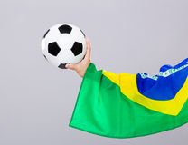 Man arm hold soccer ball Royalty Free Stock Photography