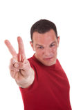 Man with arm raised in victory sign Stock Photography