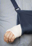 Man with arm in sling Royalty Free Stock Photo