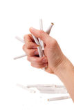 A man arm is thrashing cigarettes Royalty Free Stock Images