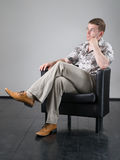 Man in armchair Royalty Free Stock Photos