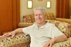 Man in armchair Royalty Free Stock Photos