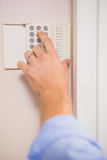 Man arming a home alarm Royalty Free Stock Images