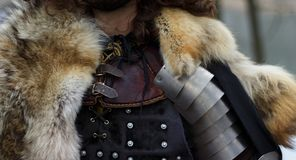 Man in armor. And in a fur cape Royalty Free Stock Image