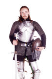 The man in armor. Knight. Shooting in a studio in the armor, and people with weapons Stock Images