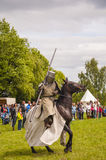 Man in armor of a medieval knight on a horse. Stock Photography
