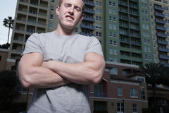 Man with arms crossed Stock Images