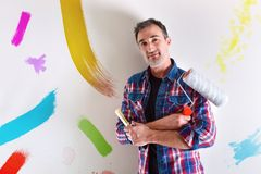 Man with arms crossed with color samples on the wall royalty free stock photography