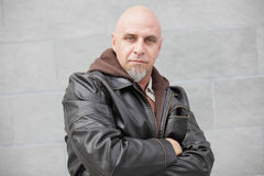 Man with arms crossed in a leather jacket Royalty Free Stock Photo