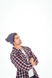 Man with arms crossed looking up Stock Photos