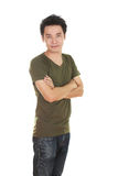 Man with arms crossed, wearing t-shirt Royalty Free Stock Photo