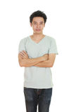 Man with arms crossed, wearing t-shirt Royalty Free Stock Photos