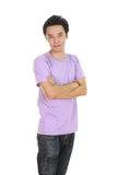 Man with arms crossed, wearing t-shirt. Man with arms crossed, wearing purple t-shirt isolated on white background Stock Images