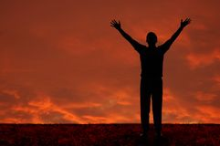 Man with arms extended. Toward heaven Stock Images