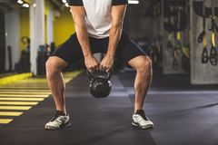 Man arms holding hard kettlebell stock images