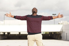 Man with arms outstretched Royalty Free Stock Photos