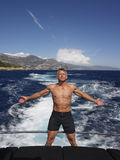 Man With Arms Outstretched Standing On Yacht Stock Images