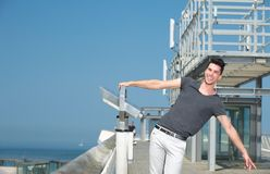 Man with arms outstretched on a summer day Stock Image