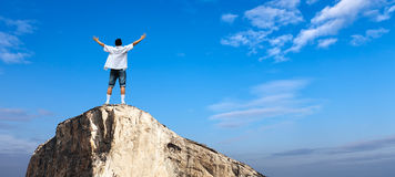 Man with arms raised in the sky Panoramic view Stock Image