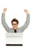 Man with arms raised using laptop. Happy man with arms raised using laptop Stock Image