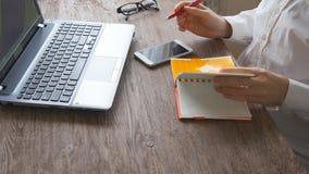 Man arms typing on keyboard at natural hardwood desk stock video footage