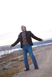 Man with arms wide open. At the beach Royalty Free Stock Image