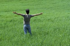 Man with arms wide open. Man alone with arms wide open Royalty Free Stock Images