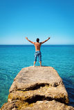 Man with Arms Wide Open on Blue Tropical Sea Stock Photography