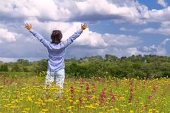Man with arms wide open in the middle of the field Stock Photography