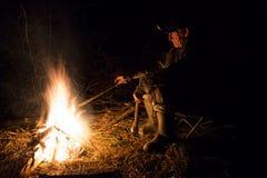 Man around the campfire Royalty Free Stock Photos